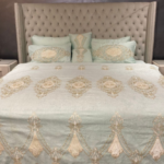 hands on embroidered bedsheets to make your bedroom look more elegant